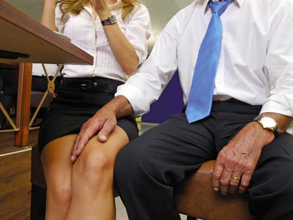 Man touching woman's thigh