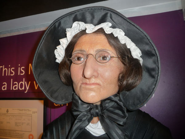 Mme Tussaud in black