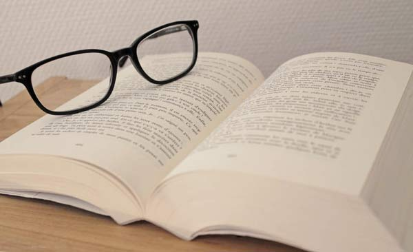Paperback and glasses