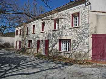 Les Pastras - House with red shutters